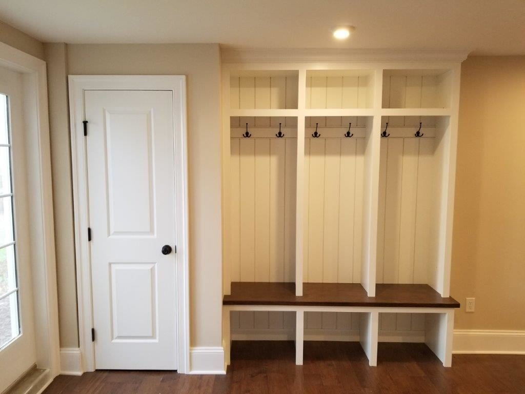 Custom mud room hangers and shelving